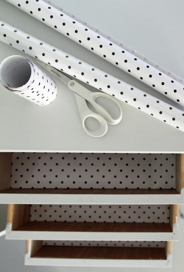 Hyllypaperi laatikoissa